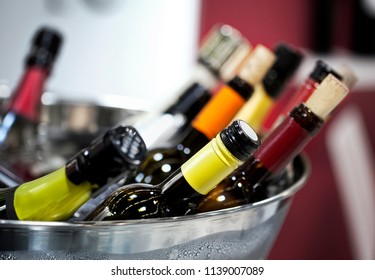 Close up of wine bottles on a bucket for tasting