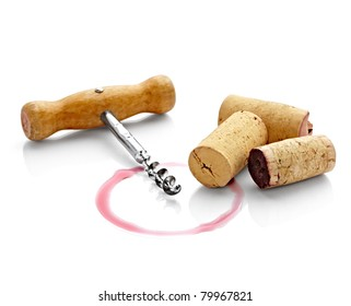 close up of  a wine stains and cork opener on  white background with clipping path