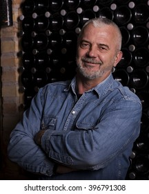 Close up of winemaker in the wine cellar