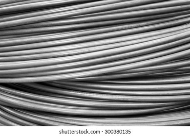 Close up wire coil texture in black and white for industrial background