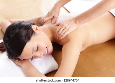 close up of Woman in beauty salon having massage of shoulder, asian woman model