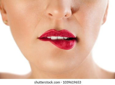 Close up of woman biting her lips, seductive lips of a woman