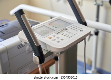 Close up of woman Body Composition Analysis by doctor before Fitness Activity. Woman Checking body with Body Composition Analysis machine. Health care, fitness and weight loss