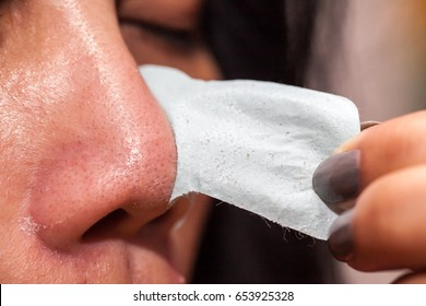 close up of woman with clear-up strips on nose