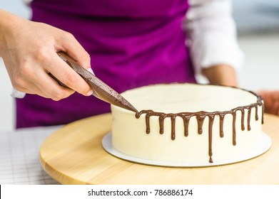 Close up woman is decorating the cake