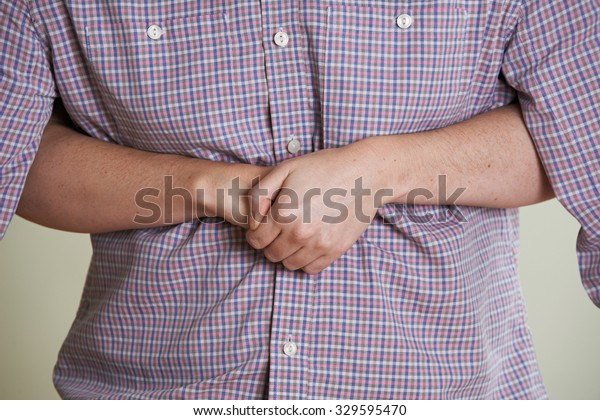 Close Up Of Woman Demonstrating Heimlich Maneuver In First