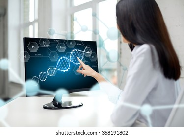 close up of woman with dna molecule on computer