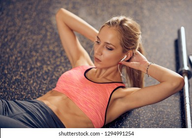 Close up of woman doing crunches in gym. Healthy lifestyle concept.