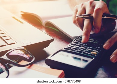 Close up woman doing finance at home office with calculate expenses
