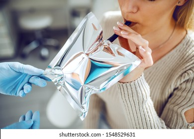 Close up of woman doing test for Helicobacter pylori.