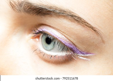 close up woman eye with bright makeup
