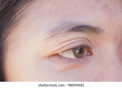 Close up of woman eye wearing fancy contact lens