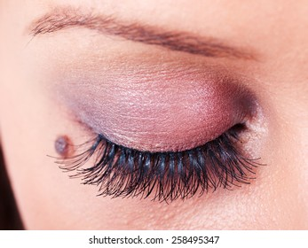 Close up of woman eye when applying eye pencil