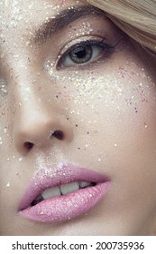 Close up of woman face with glitter on face