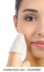 Close up of a woman face removing make up with a baby wipe isolated on a white background