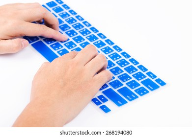 Close up woman finger on blue Thai keyboard cover