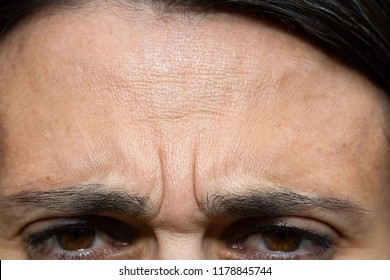 Close up of woman with frowned face
