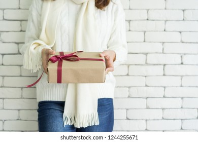 close up woman hand holding gift box in living room and giving to someone for special day , lifestyle concept