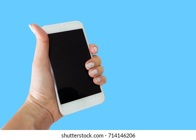 Close Up Woman Hand Holding Phone with Black Screen on Blue Background Great For Any Use.