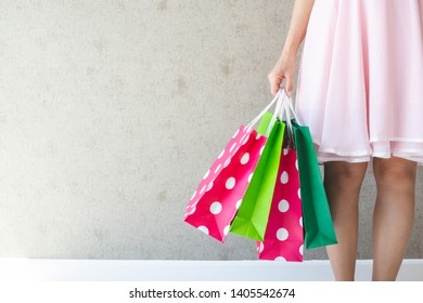 Close up of woman hand holding shopping bags.