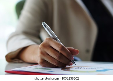 close up woman hand with pen sign on the document. female hand holding pen, putting signature at official paper, subscribing name in statement with legal value, contract management, good business.