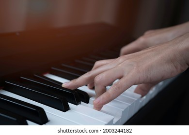 Close up woman hand press paino keybord, musical school, practicing paino, right position hand on keyboard.