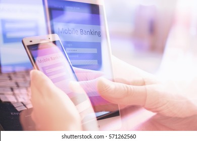 Close up of woman hand using on line banking on mobile phone logging in to a bank account typing password. Business, financial and secure payment concept abstract background.