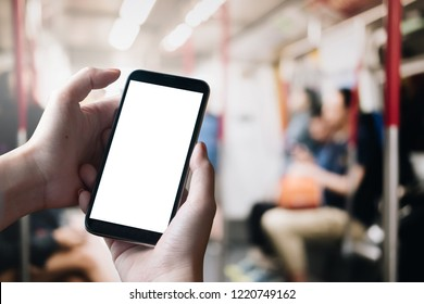 Close up Woman hand Using a Smart Phone with blank screen at Train.