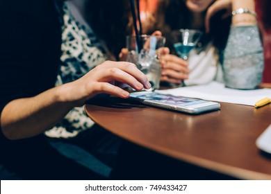 close up woman hand using smart phone - social network, technology, internet concept