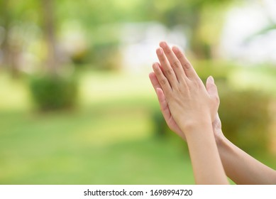 close up woman hands is applying alcohol sanitizer outdoor