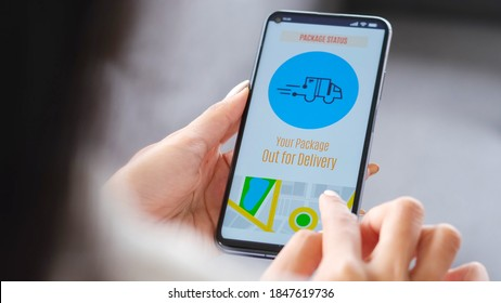 Close up of woman hands checking parcel delivers order on mobile app while sitting on the sofa at home during the quarantine, Delivery application on smartphone device screen