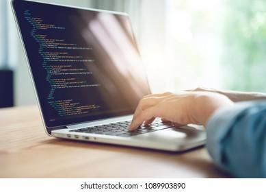 Close up Woman hands coding html and programming on screen laptop, development web, developer.