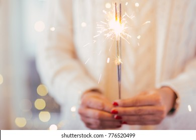 Close up of woman hands holding sparkler