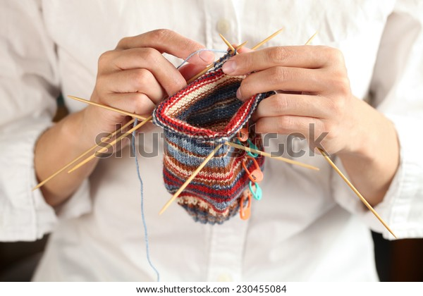 close up of woman hands knitting with knitting needles