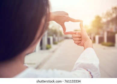 Close up of woman hands making frame gesture with sunlight outdoor, Future planning concept.