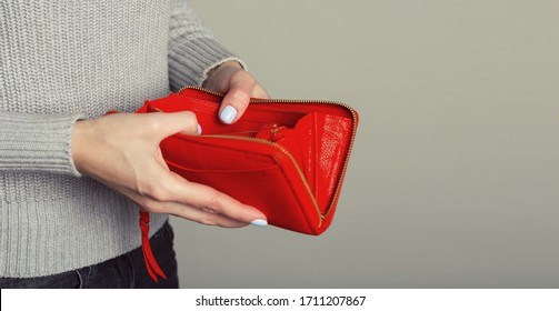 Close up of woman hands open an empty wallet.  Financial turmoil crisis. Lack of money.  Unemployment.  Unemployed.  Poverty. Copy space. Space for text. Free text.  Economic meltdown.