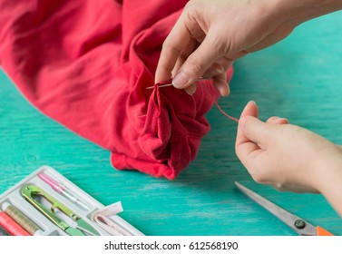 Close up woman hands sewing,Housewife holiday concept.House work,
