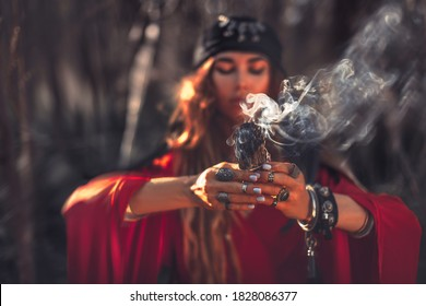close up of woman hands with shamanic fire outdoors