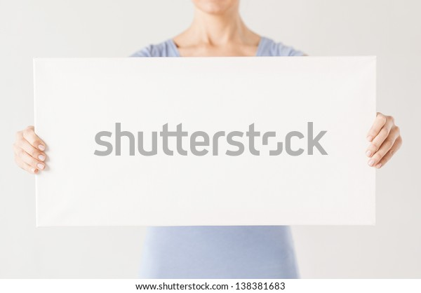 close up of woman hands showing white blank board
