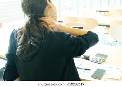 Close up woman having neck pain. Office syndrome concept.