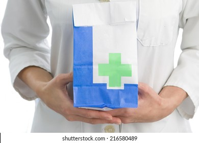 Close up of woman holding prescription bag