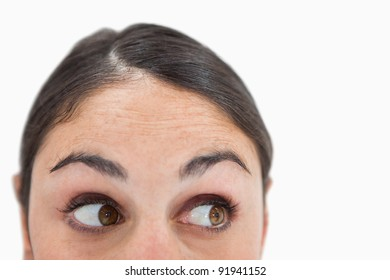 Close up of a woman looking away from the camera against a white background