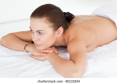 Close up of a woman lying on her belly on a massage table in a spa