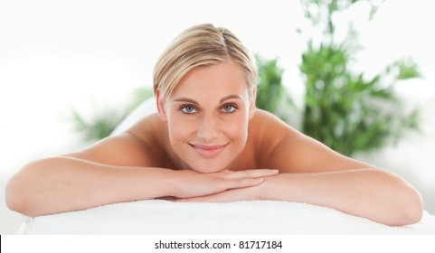 Close up of a woman lying on a lounger in a wellness center