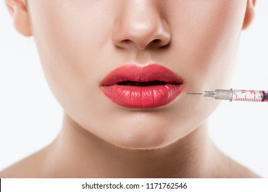 close up of woman making beauty injection in lips, isolated on white