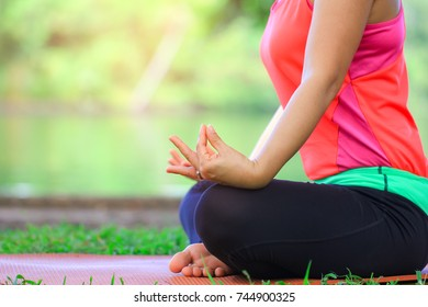 Close up Woman meditating to relax in nature, Healthy lifestyle concept