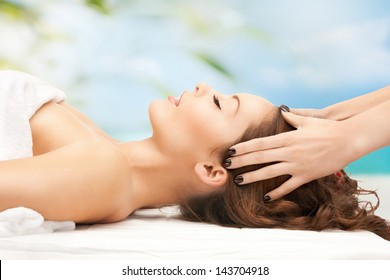 close up of woman on resort getting head spa treatment