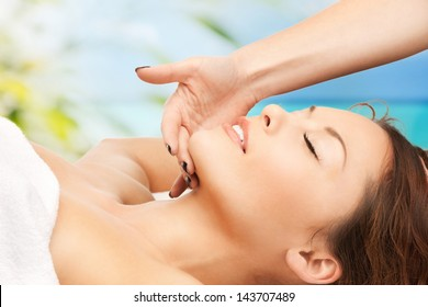close up of woman on resort getting face spa treatment