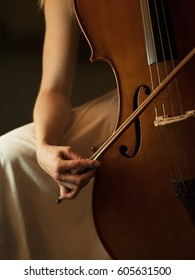 close up of woman playing cello