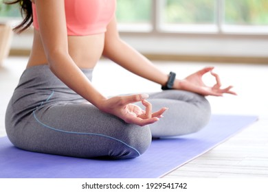 Close up of woman practice yoga meditation exercise at home, Young female sitting on mat for relaxed yoga posture in the morning , exercise at home, wellbeing, mental health care